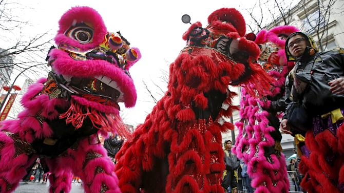 Members of the Asian community take part in a parade to celebrate Chinese New Year in Paris