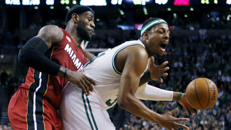 Miami Heat's LeBron James (6) knocks the ball away from Boston Celtics' Paul Pierce (34) in the second quarter of an NBA basketball game in Boston, Monday, March 18, 2013. (AP Photo/Michael Dwyer)