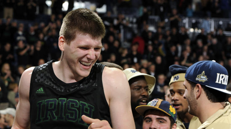 Notre Dame forward Jack Cooley celebrates after the team's 64-50 victory over Kentucky in an NCAA college basketball game Thursday, Nov. 29, 2012, in South Bend, Ind. (AP Photo/Joe Raymond)