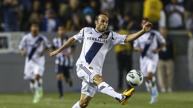 FILe - In this April 3, 2013, file photo, Los Angeles Galaxy midfielder Landon Donovan controls the ball during the second half of a CONCACAF Champions League semifinal against Monterrey in Carson, Calif. Donovan has been left off the 29-man U.S. roster for a training camp ahead of a trio of World Cup qualifiers next month. (AP Photo/Bret Hartman, File)
