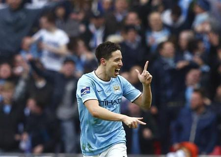 Manchester City's Nasri celebrates after scoring a goal against Sunderland during their English League Cup final soccer match at Wembley Stadium in London