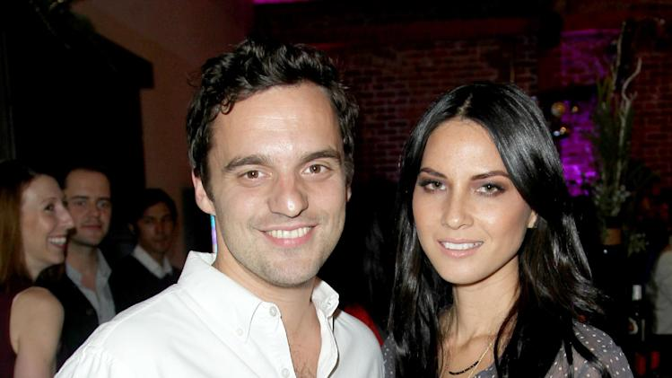 IMAGE DISTRIBUTED FOR MICROSOFT -  Jake Johnson, left, and Olivia Munn are seen with Windows Phone  8X by HTC at Microsoft All Access Holiday Party on Thursday, Dec. 6, 2012, in Venice, Calif. (Photo by Matt Sayles/Invision for Microsoft/AP Images)