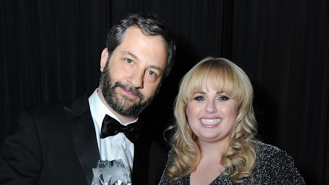 Judd Apatow toasts his Critics' Choice LOUIS XIII Genius Award with Rebel Wilson at the Critcs' Choice Movie Awards at Barker Hangar on Thursday, January 10, 2013 in Santa Monica, Calif. (Photo by Jordan Strauss/Invision for LOUIS XIII/AP Images)