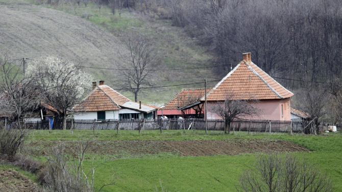 Serbian police officers inspect gardens in the village of Velika Ivanca, Serbia, Tuesday, April 9, 2013. A 60-year-old man gunned down 13 people, including a baby, in a house-to-house rampage in the quiet village on Tuesday before trying to kill himself and his wife, police and hospital officials said. Belgrade emergency hospital spokeswoman Nada Macura said the man, identified only as Ljubisa B., used a handgun in the shooting spree at five houses. The dead included six women.(AP Photo/Darko Vojinovic)