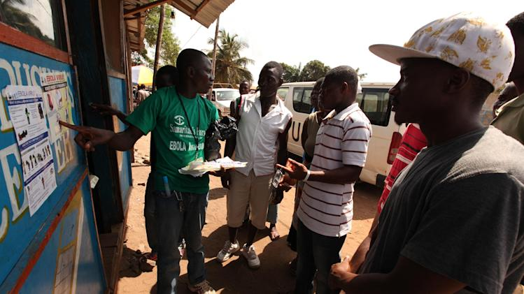 A Samaritan's Purse team member hands out pamphlets to educate the public on the Ebola virus in Monrovia in this undated handout photo