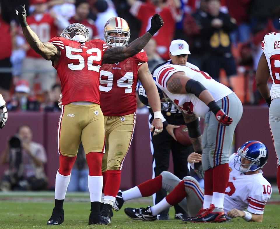 San Francisco 49ers linebacker Patrick Willis (52) celebrates after sacking New York Giants quarterback Eli Manning, bottom rear, in the third quarter of an NFL football game in San Francisco, Sunday, Nov. 13, 2011. (AP Photo/Marcio Jose Sanchez)