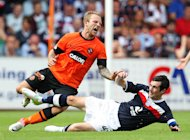 Johnny Russell (left) and Stephen O'Donnell are both appealing red cards