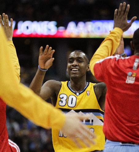 Denver Nuggets' Quincy Miller (30) reacts after making an uncontested slam dunk against the Oklahoma City Thunder during the third quarter of an NBA basketball game Thursday, Jan. 9, 2014, in Denv