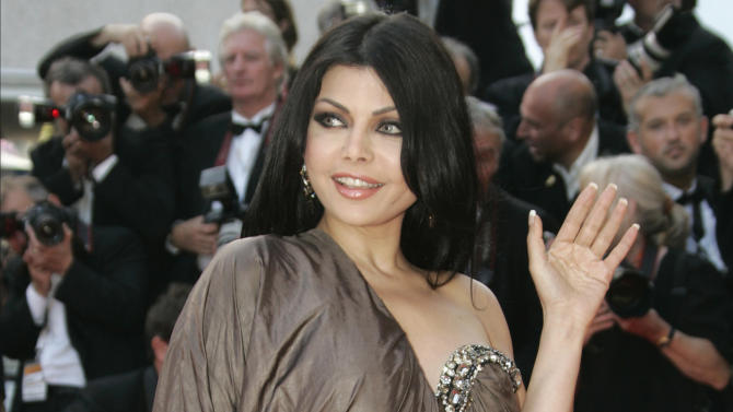 "FILE -- In this Thursday, May 24, 2007 file photo, Lebanese singer Haifa Wehbe arrives for the screening of the film ""Ocean's Thirteen,"" at the 60th International film festival in Cannes, southern France. The head of Egypt's censorship board says he has resigned after the country's prime minister overruled his decision to allow a film starring Haifa Wehbe to be shown. Prime Minister Ibrahim Mahlab said he stopped the film from being shown in response to calls from the National Council for Motherhood and Childhood and ""to preserve the morals of our children."" In the film, Lebanese sex symbol Haifa Wehbe has a young boy infatuated with her character. (AP Photo/Kirsty Wigglesworth, File)"