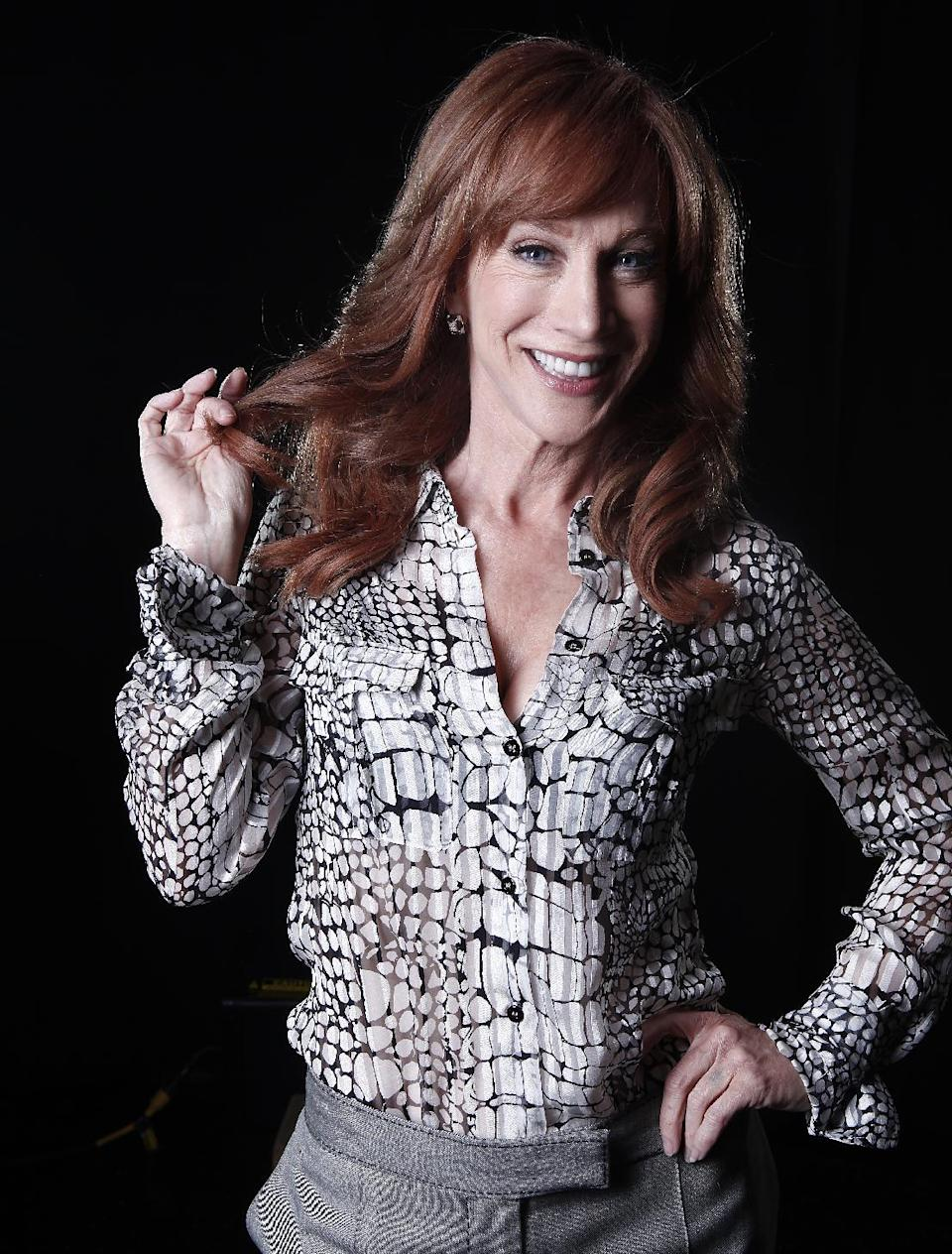 "In this April 4, 2012 photo, comedian and Bravo TV personality Kathy Griffin poses for a portrait in New York.  Griffin's new weekly talk show on Bravo ""Kathy"" premieres Thursday, April 19.  (AP Photo/Carlo Allegri, file)"