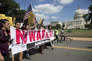 Protesters against U.S. military action in Syria march…