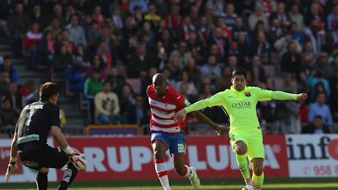 Barcelona's Suarez kicks the ball to score a goal against Granada during their Spanish first division soccer match in Granada