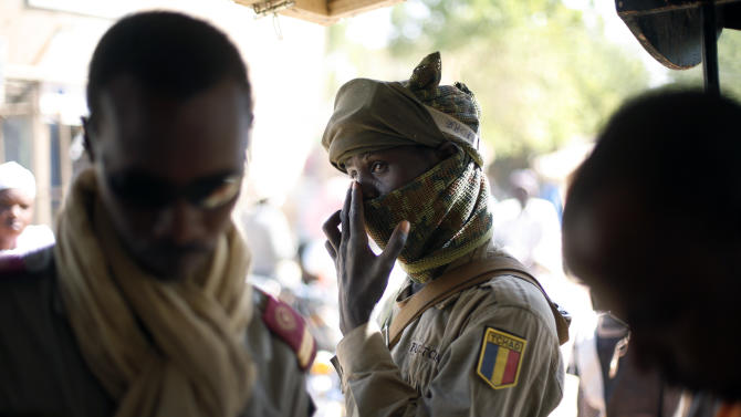 A Chadian soldier shops in the central market in Gao, Northern Mali, Wednesday Jan. 30, 2013.  The mission by French troops scored another success in its effort to dislodge the al-Qaida-linked militants from northern Mali, and freed from Islamic rule over the weekend, women started coming out wearing bright colors, makeup and jewels, after 10-month of black veils and sharia laws. (AP Photo/Jerome Delay)