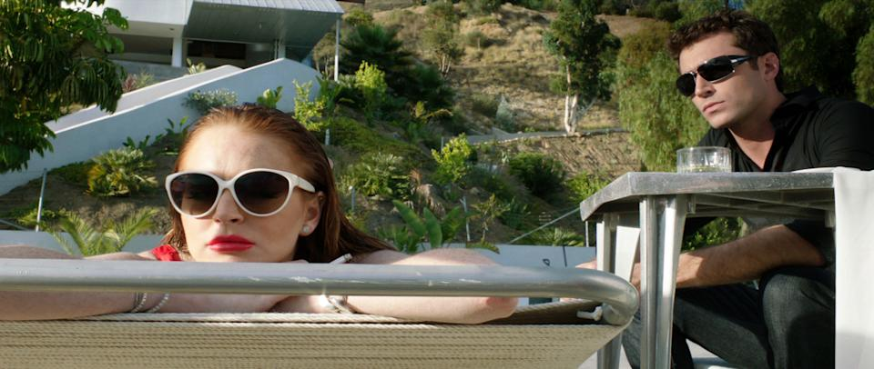 "This film image released by IFC Films shows Lindsay Lohan, left, and James Deen in a scene from ""The Canyons."" (AP Photo/IFC Films)"