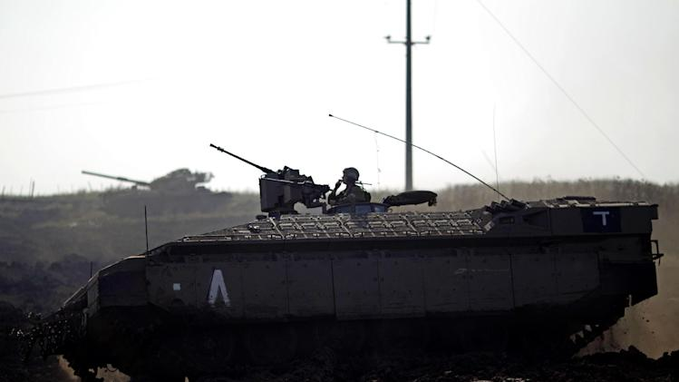 An Israeli soldier drives an armored personal carrier during a military exercise in the Israeli controlled Golan Heights, near the border with Syria, Tuesday, May 7, 2013. (AP Photo/Ariel Schalit)