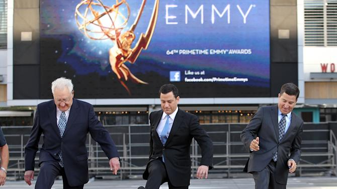 Don Mischer, executive producer of the 64th Primetime Emmy Awards, left, host Jimmy Kimmel, center, and Television Academy chairman and chief executive Bruce Rosenblum attend the Emmy Awards Red Carpet Rollout at the Nokia Theatre on Wednesday, Sept. 19, 2012, in Los Angeles. The Emmy Awards will be held Sunday, Sept 23. (Photo by Matt Sayles/Invision/AP)