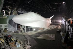 Replica Rocket Boosters Rise Over Space Shuttle Atlantis Exhibit