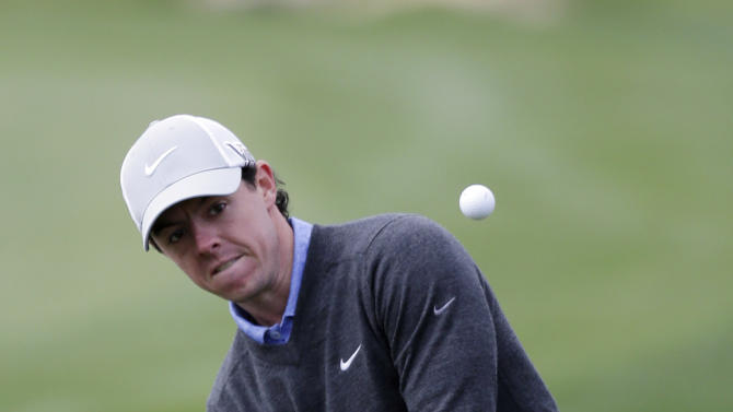 Rory McIlroy, of Northern Ireland, chips to the 18th green during the first round of the Texas Open golf tournament, Thursday, April 4, 2013, in San Antonio.  (AP Photo/Eric Gay)