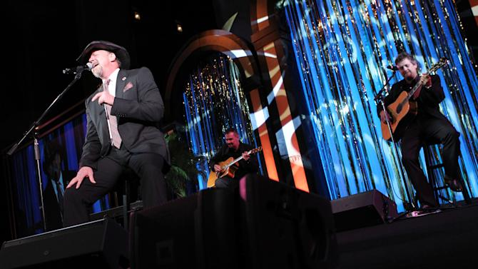 """Country music star Trace Adkins performs a song from his new album """"Love Will…"""" after receiving the American Red Cross Crystal Cross Award for his support of the Red Cross at the National Building Museum on Saturday, May 18, 2013 in Washington, D.C. (Paul Morigi/AP Images for American Red Cross)"""