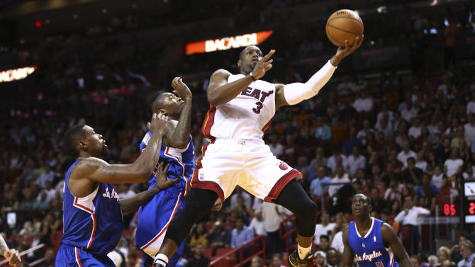 Wade lifts Heat over Clippers, 102-97
