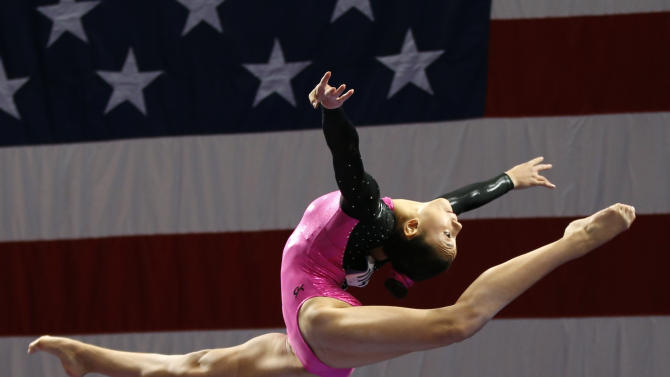 Kyla Ross competes on the balance beam during the U.S. women's national gymnastics championships in Hartford, Conn. Thursday, Aug. 15, 2013. (AP Photo/Elise Amendola)