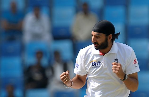 England's cricketer Monty Panesar celebrates after he dismissed Pakistan's cricketer Saeed Ajmal (unseen) during the first day of the third and final Test match between Pakistan and England at