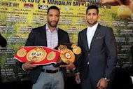 "Lamont Peterson (L) and Amir Kahn at a press conference in Washington in March 2012. Peterson's camp is ""disappointed and distraught"" by the decision to cancel a world light-welterweight title showdown next week against Khan after the American failed a drug test"