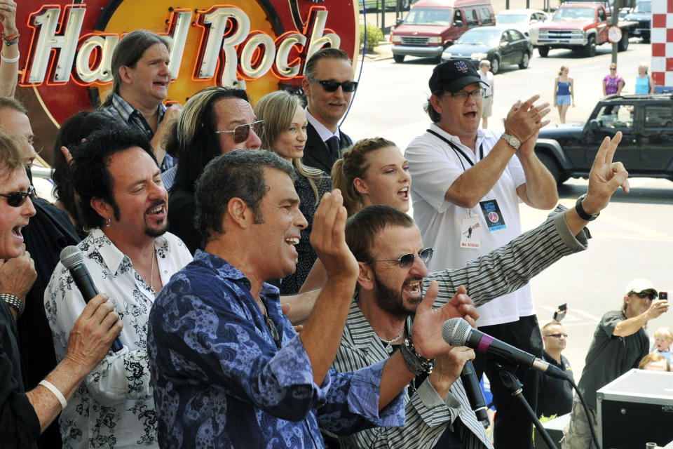 In this photo provided by Rob Shanahan, musician Ringo Starr, bottom right, celebrates his 72nd birthday at The Hard Rock Cafe while on tour with his All-Starr Band, Saturday, July 7, 2012, in Nashville, Tenn. (AP Photo/Rob Shanahan)