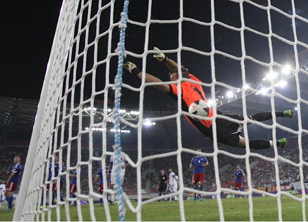 Liechtenstein's goalkeeper Peter Jehle fails to save a goal from Greece's Giorgos Karagounis during their World Cup Group G qualifying soccer match against Liechtenstein at the Karaiskaki stadium in t