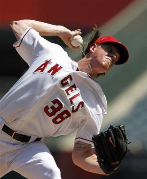 Weaver, Angels snap Oakland's road streak at 12