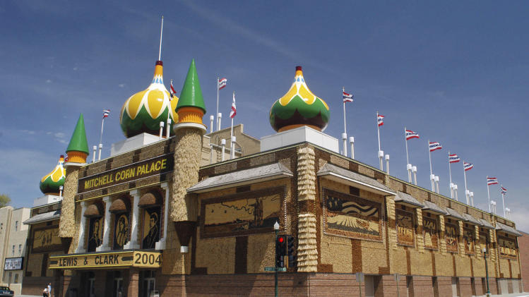 FILE - This May 6, 2004 file photo shows the Corn Palace in Mitchell, S.D. The iconic domes and turrets have been removed from the building as a $7.2 million makeover project gains steam. The Corn Palace upgrade will include new domes and lighting, larger corn murals and a walk-out balcony above the marquee. Changes to the building's exterior are being done during the $4 million first phase, which got underway in June 2014. The Corn Palace bills itself as the world's only palace dedicated to the grain. About 200,000 tourists visit each year. (AP Photo/Doug Dreyer, File)