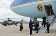 US President Barack Obama salutes as he walks off Air foirce One upon his landing at Andrews Air force Base, Maryland, on December 27, 2012. Obama will host top congressional leaders including his bitter Republican rivals on Friday in a last-ditch bid to halt America&#39;s slide over the so-called &quot;fiscal cliff.&quot;