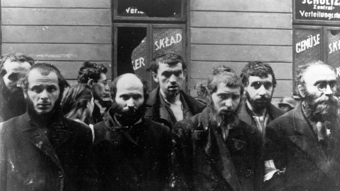 FILE - In this April/May 1943 file photo, a group of religious Jews are being held under arrest by German SS soldiers during the destruction of the Warsaw Ghetto by German troops, following an uprising in the Jewish quarter. Friday, April 19, 2013 anniversary of the start of the Warsaw ghetto uprising, a revolt that ended in death for most of the fighters yet gave the world an enduring symbol of resistance against the odds. (AP Photo)
