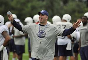 Penn State football coach O'Brien yells at members of the media to put away their cameras during a team practice in State College, Pennsylvania