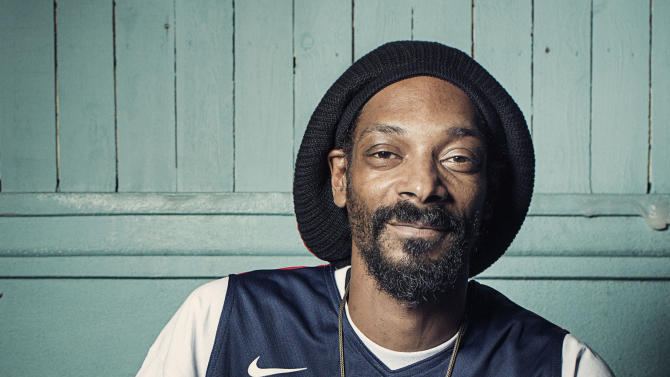 "FILE - This July 30, 2012 photo shows Snoop Dogg posing for a portrait at Miss Lily's in New York. The rapper smoked during the BMI's annual pre-Grammy Awards ""How I Wrote That Song"" panel discussion at the Roxy in Los Angeles on Saturday, Feb. 9, 2013 on the eve of the Grammy Awards. (Photo by Victoria Will/Invision/AP, file)"