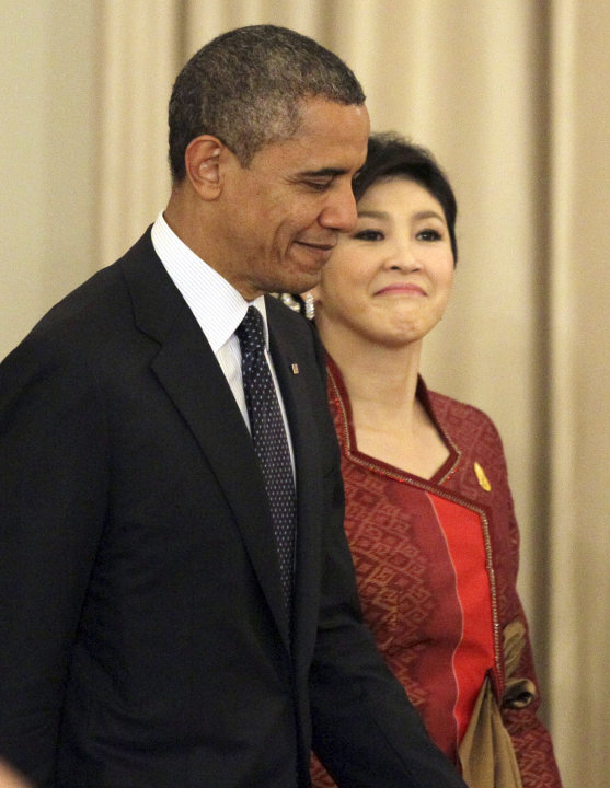 U.S. President Barack Obama, left, and Thai Prime Minister Yingluck Shinawatra arrive for a joint press conference at the Government House in Bangkok, Thailand, Sunday, Nov. 18, 2012. (AP Photo/Sakcha