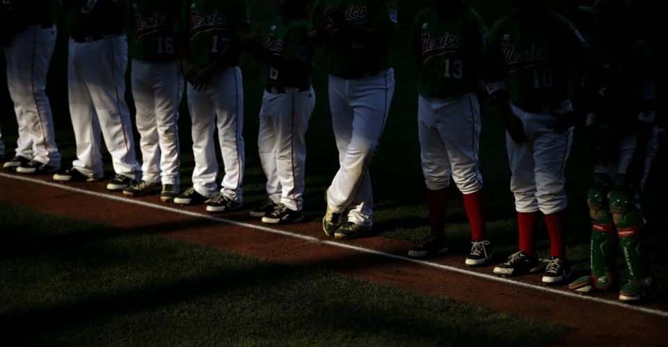 Nuevo Laredo, Mexico players line up for the nation anthems before a pool play baseball game against Lugazi, Uganda at the Little League World Series, Saturday, Aug. 18, 2012, in South Williamsport, Pa. Mexico won 12-0. (AP Photo/Matt Slocum)