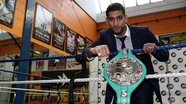 Amir Khan poses with his WBC Silver super-lightweight belt in the ring during a media day at the at the Gloves Community Centre on December 19, 2012 in Bolton (photo: Clive Brunskill)