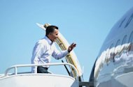 <p>Republican presidential candidate Mitt Romney boards his campaign plane at Los Angeles International Airport. Romney hits the campaign trail hard this week to try to inject some fresh momentum into his flagging presidential bid as polls show his path to the White House narrowing.</p>