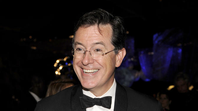 """FILE - This Sept. 18, 2011 file photo shows Stephen Colbert at the 63rd Primetime Emmy Awards Governors Ball in Los Angeles. Colbert is hosting another music extravaganza, and this time, he's got missiles. The comedian announced Tuesday, July 31, 2012, on """"The Colbert Report"""" that he will host a concert on Aug. 10 aboard the Intrepid Sea, Air and Space Museum in New York. Performing will be the Flaming Lips, Santigold, Grandmaster Flash, Grizzly Bear and the band fun.  (AP Photo/Chris Pizzello, file)"""