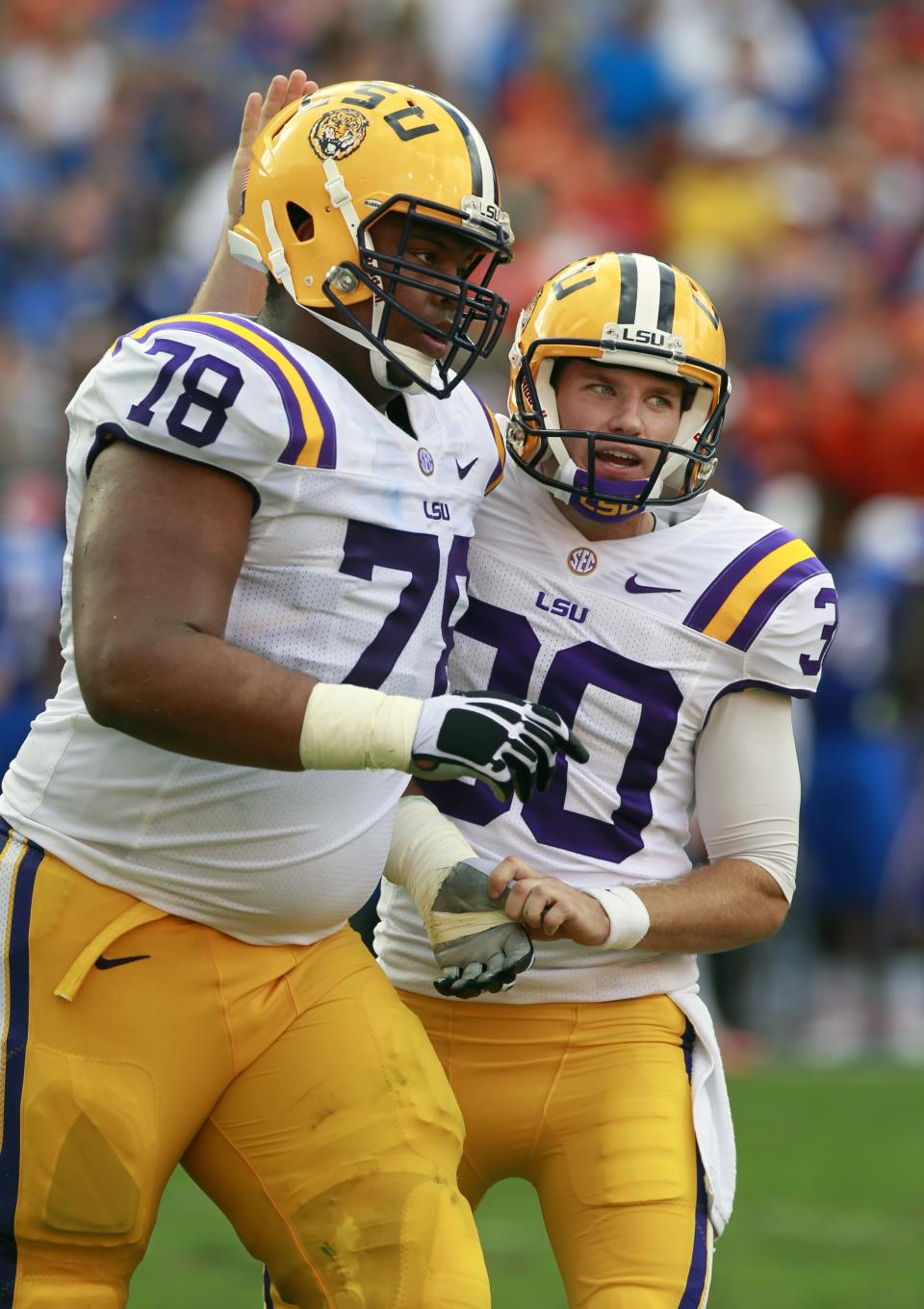 LSU place kicker Drew Alleman, right, pats offensive tackle Vadal Alexander (78) on the helmet after Alleman kicked a 21-yard field goal against Florida during the first half of an NCAA college football game, Saturday, Oct. 6, 2012, in Gainesville, Fla. (AP Photo/John Raoux)