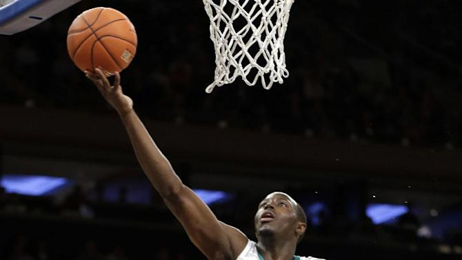 Rutgers' Austin Johnson (21) draws a foul as Notre Dame's Jerian Grant (22) attempts to score during the first half of an NCAA college basketball game at the Big East Conference tournament, Wednesday, March 13, 2013, in New York. (AP Photo/Frank Franklin II)