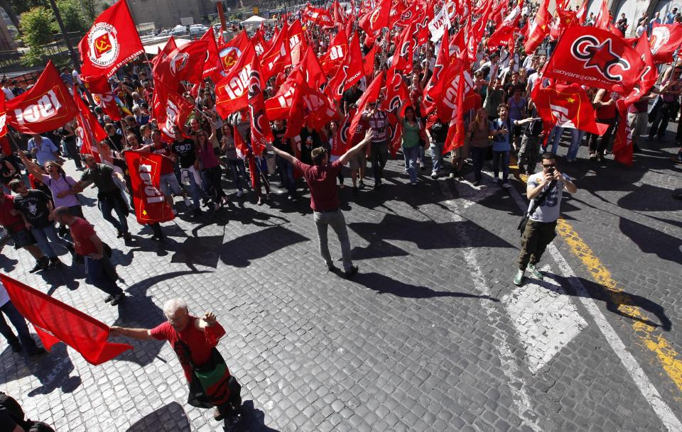 Rifondazione Comunista far-left wing party demonstrators protest against Italian government's austerity plans in Rome, Saturday, May 12, 2012. (AP Photo/Alessandra Tarantino)