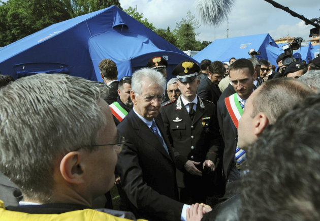 Italian Premier Mario Monti visits a tent camp in the village of Finale Emilia, in the area hit by an earth quake, Tuesday, May 22, 2012. Italian Premier Mario Monti has promised to help small-scale businesses, especially factories and farms, in the region of northern Italy struck by quake. Monti's visit to the Emilia Romagna region included a stop at a ceramics factory where two workers died after it collapsed. In all, the quake claimed seven lives. (AP Photo/Gianfilippo Oggioni, Lapresse)