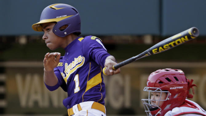 Aguadulce, Panama's Daniel Cruz drives in the team's only run with a fifth-inning double off Tokyo pitcher Ryuji Osada in a baseball game at the Little League World Series in South Williamsport, Pa., Wednesday, Aug. 22, 2012. Catching is Tokyo's Tatsuya Irie. Tokyo won 4-1. (AP Photo/Gene J. Puskar)