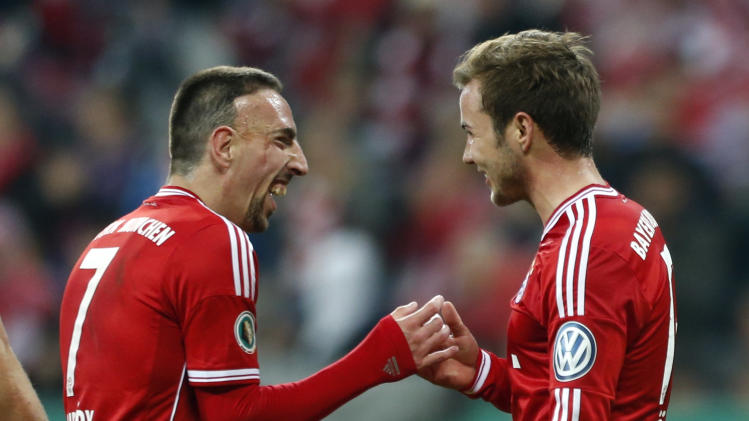 Bayern Munich's Goetze celebrates with Ribery after scoring against 1.FC Kaiserslautern during their German soccer cup semi-final match in Munich