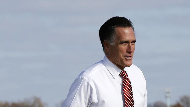 Republican presidential candidate, former Massachusetts Gov. Mitt Romney walks back to his vehicle after he briefly watched military jets take off upon his arrival at Des Moines International Airport in Des Moines, Iowa, Friday, Oct. 26, 2012, before heading to a campaign event in Ames, Iowa. (AP Photo/Charles Dharapak)