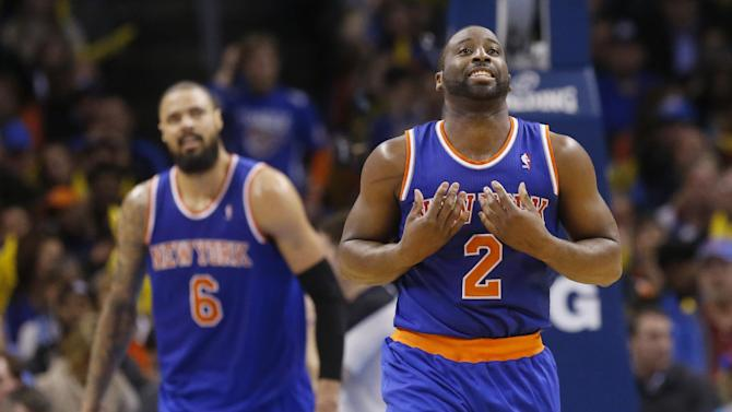 In this Feb. 9, 2014, photo, New York Knicks guard Raymond Felton (2) reacts after being called for a foul during an NBA basketball game against the Oklahoma City Thunder in Oklahoma City. At left is teammate Tyson Chadler. The Dallas Mavericks and the Knicks have agreed to a trade that would bring Chandler back to the Mavericks three years after he helped them win a championship only to leave right away in free agency. Two people with knowledge of the deal said Wednesday, June 25, 2014, the Mavericks would send guards Jose Calderon and Shane Larkin and center Samuel Dalembert to the Knicks for Chandler and Felton. The people spoke on condition of anonymity because the deal hasn't been announced