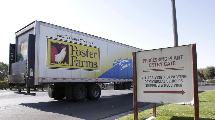FILE - This Oct. 10, 2013 file photo shows a truck entering the Foster Farms processing plant in Livingston, Calif. The Obama administration is overhauling poultry plant inspections for the first time in more than 50 years, a move it says could result in 5,000 fewer foodborne illnesses each year. The final rules announced Thursday would reduce the number of government poultry inspectors by around a fourth. But those that remain will focus more on food safety than quality, requiring them to pull more birds off the line for closer inspections and encouraging more testing for pathogens. There would also be more inspectors checking the facilities to make sure they are clean. (AP Photo/Rich Pedroncelli, File)