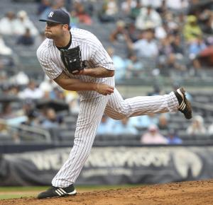 New York Yankees' Joba Chamberlain pitches during the seventh inning of the baseball game against the Baltimore Orioles, Wednesday, Aug. 1, 2012, at Yankee Stadium in New York. (AP Photo/Seth Wenig)